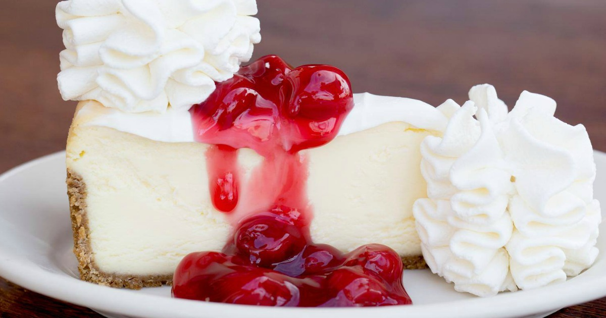 Cheesecake with cherries and whipped cream