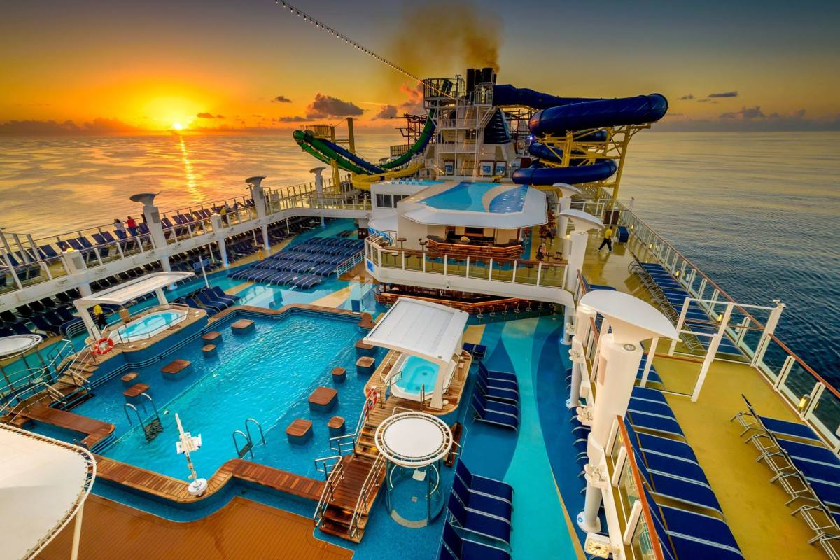 sunset in background of a cruise ship