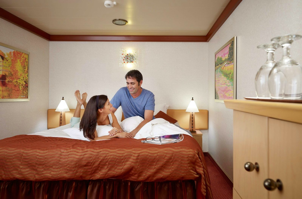couple sitting on bed in cruise room