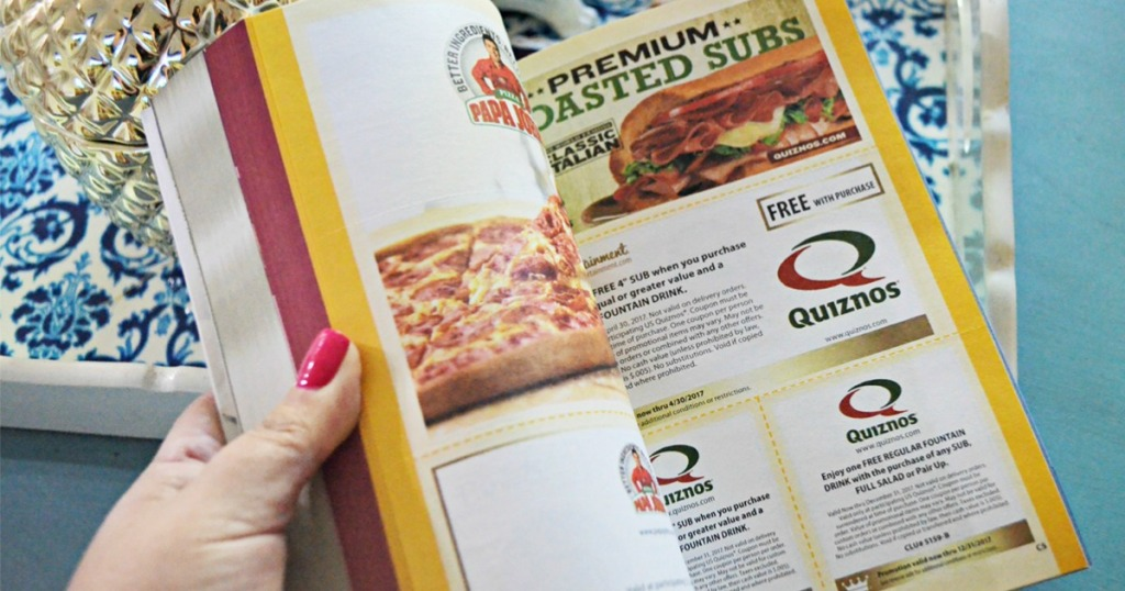 handing opening book to quiznos coupons page
