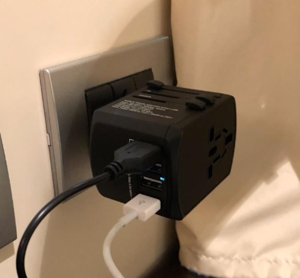 black power adapter and cords in wall