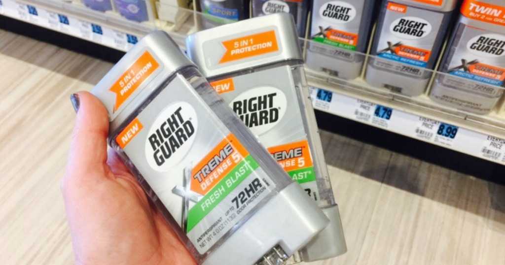 Hand holding Right Guard Xtreme Deodorant at Rite Aid