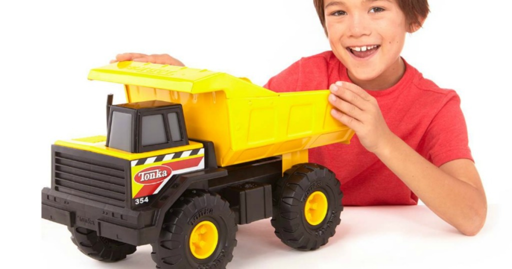 boy playing with tonka dump truck classic steel