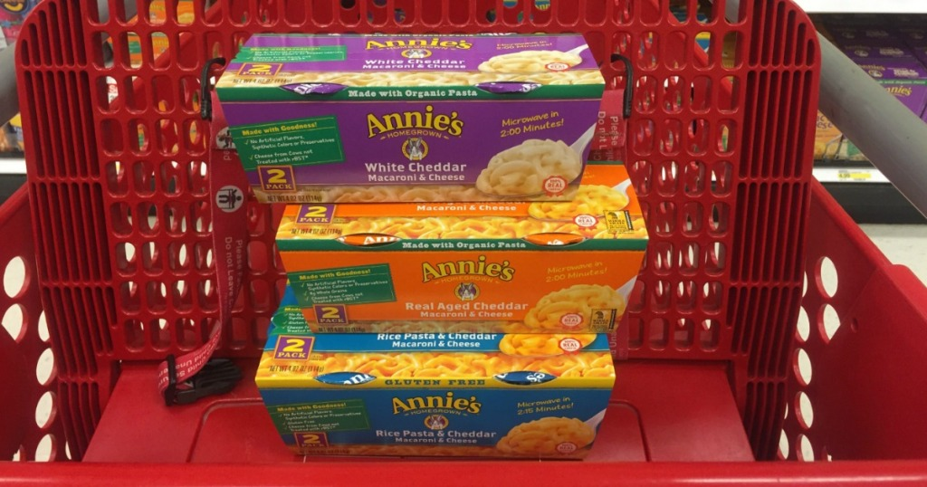 purple, orange and blue macaroni boxes in red cart