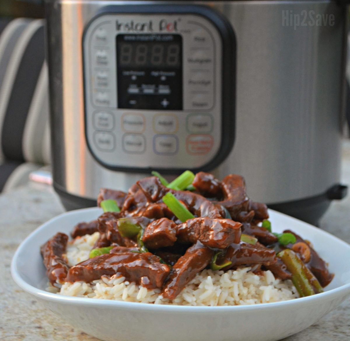 Mongolian beef served over rice in front of an instant pot
