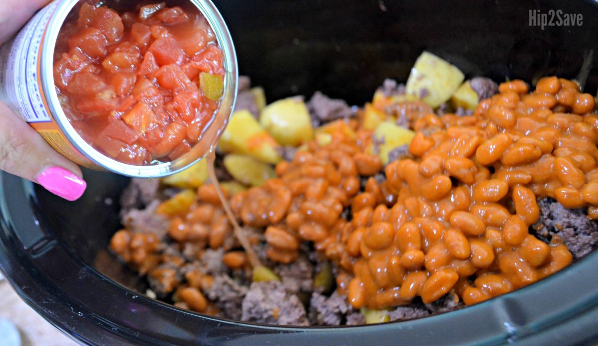 pouring ingredients into slow cooker for cowboy meal