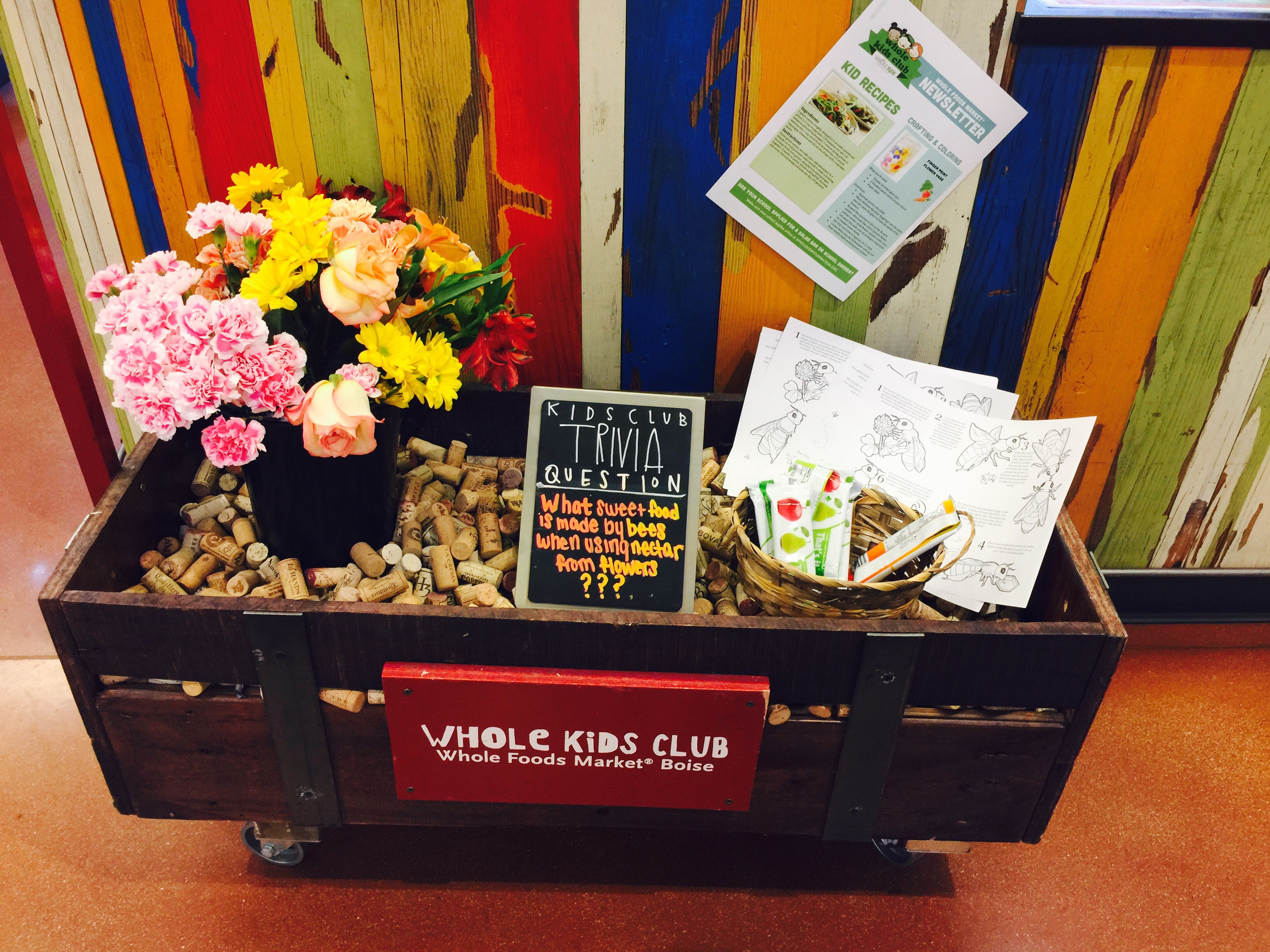 money-saving hacks at Whole Foods Market – kids' club in store display