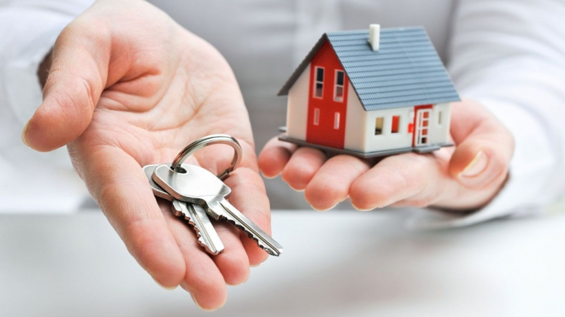 a new law provides free Credit Freezes and protection - a hand holding keys and a small house