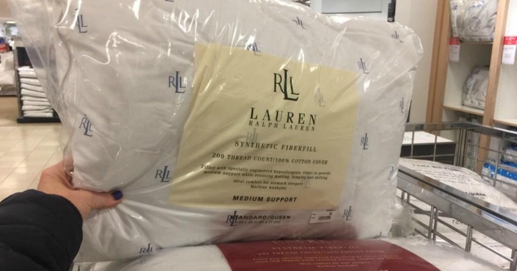hand holding Ralph Lauren Pillow