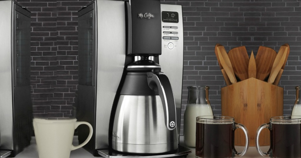 silver coffee maker on counter