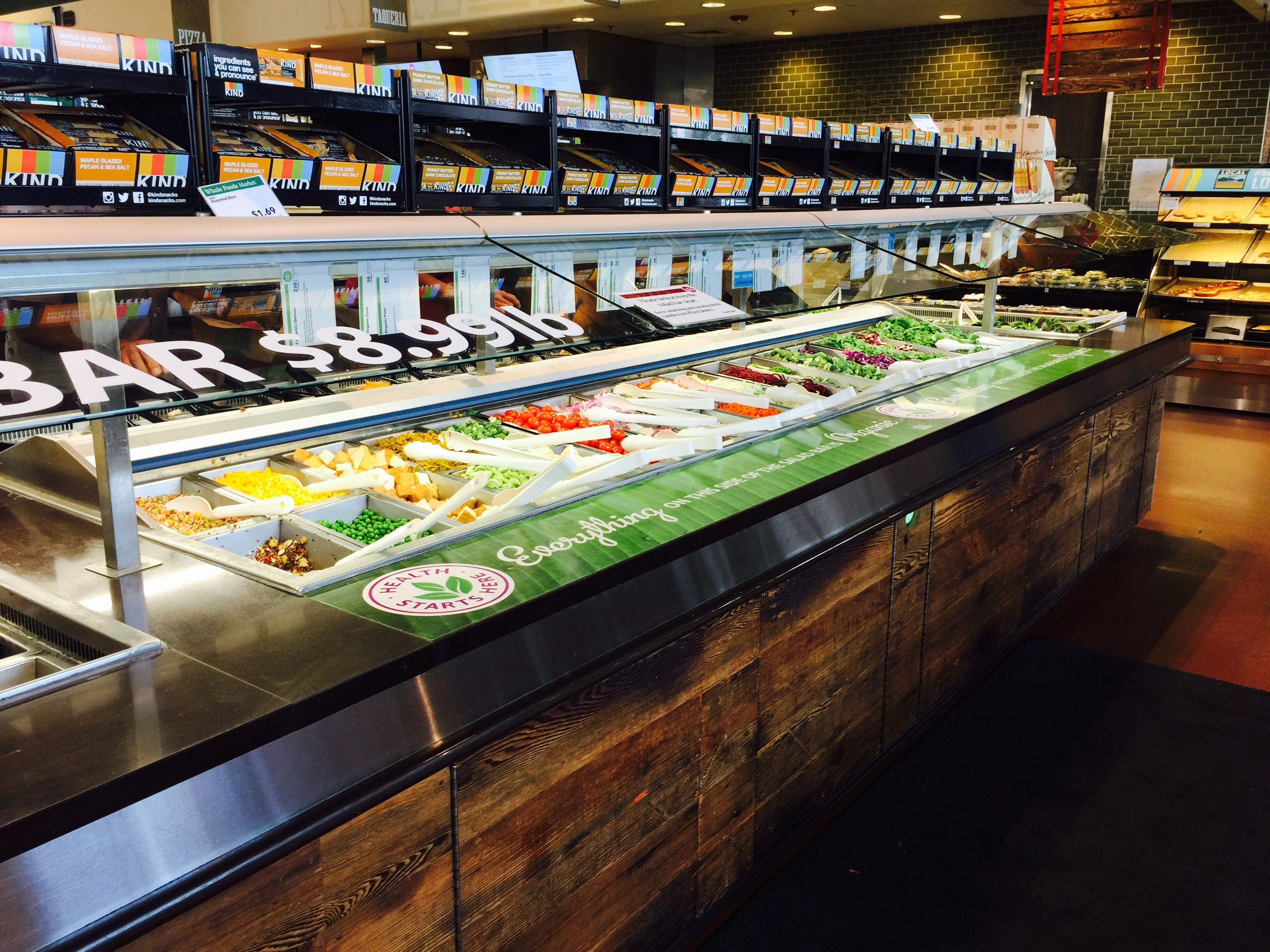 money-saving hacks at Whole Foods Market – side view of the olive and salad bar