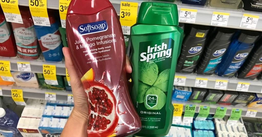 hand holding Softsoap and Irish Spring Body Wash