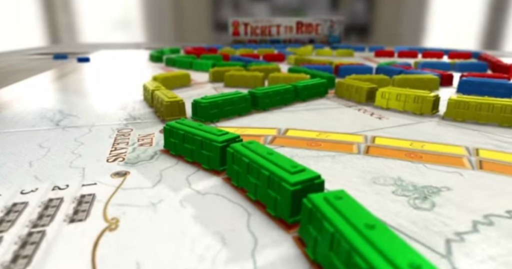 Ticket to Ride Board Game laid out on table with trains
