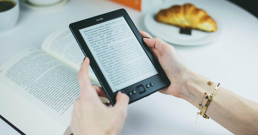 Hand holding Kindle eReader