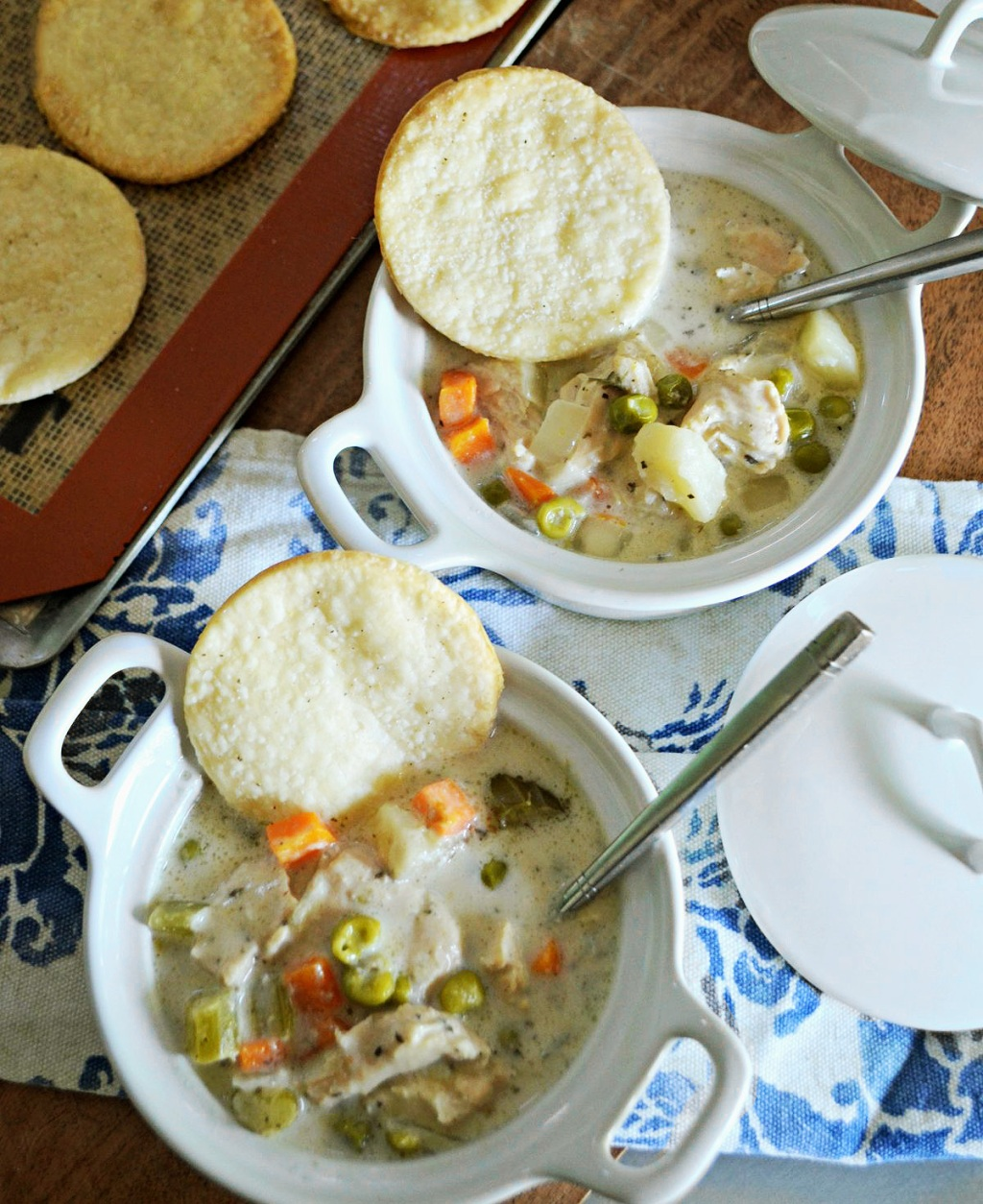 chicken pot pie soup in bowls on table