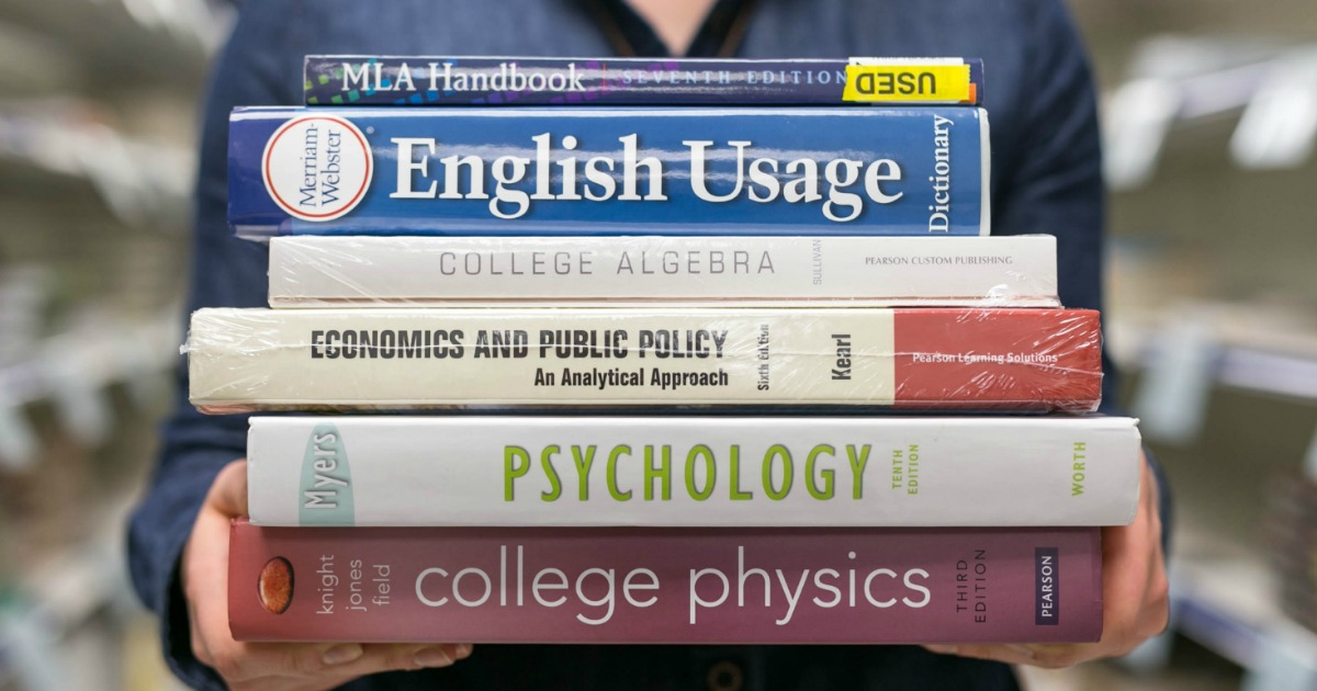 22 college student discounts & freebies – a student holding textbooks