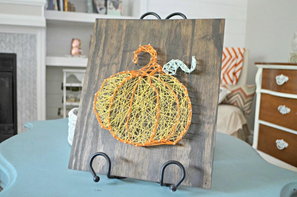 fall pumpkin string art on a table