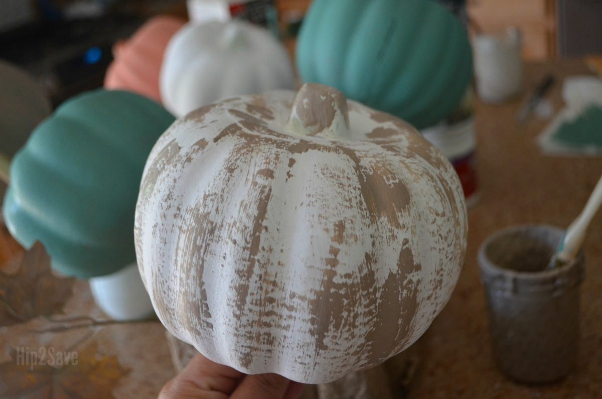 craft pumpkin covered in white and tan paint