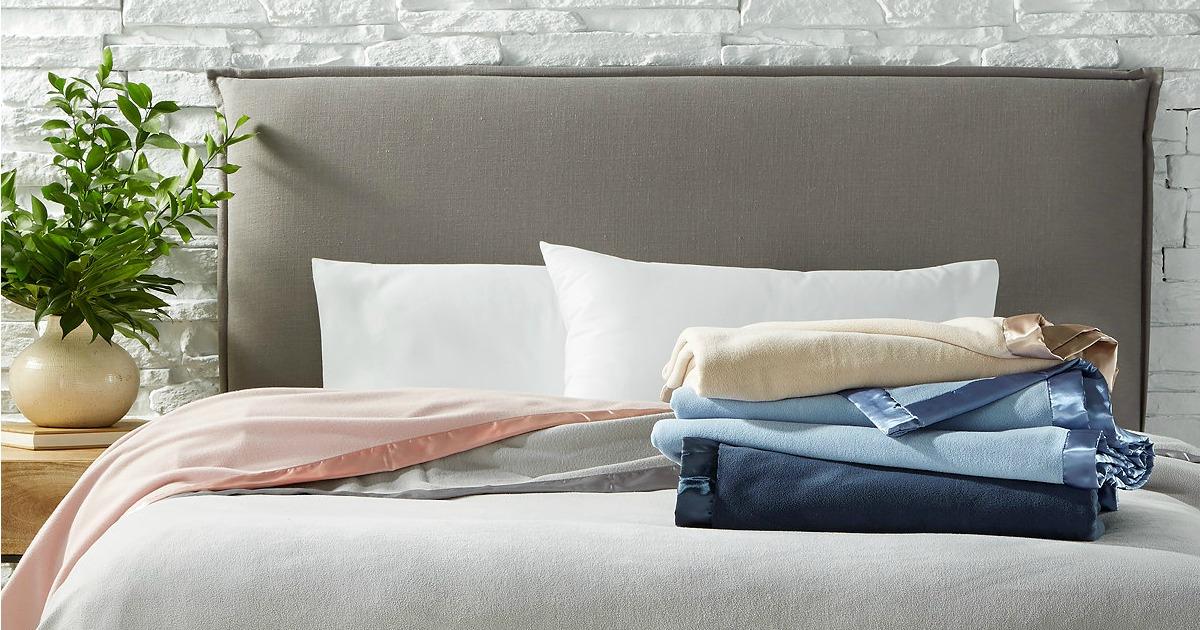 Martha Stewart Soft Fleece Blankets folded up on bed