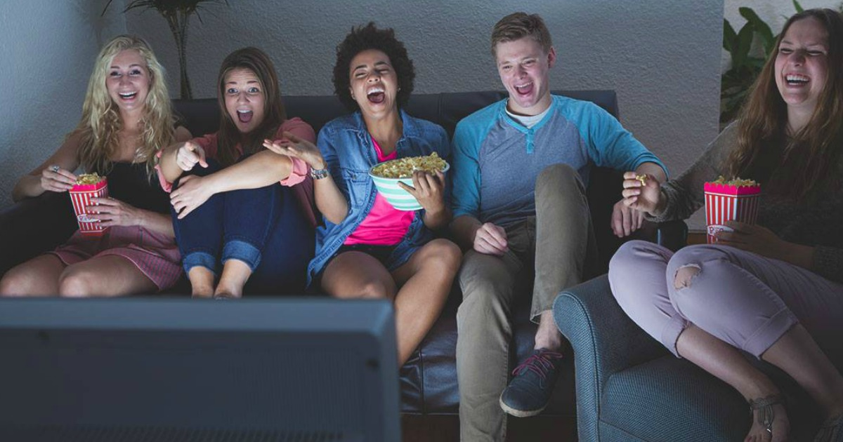 people on couch watching tv