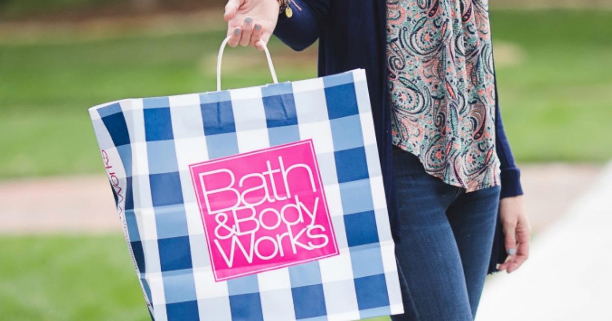 16 secrets for saving big at bath & body works – collin holding a B&BW bag