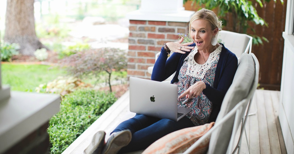 woman with laptop on porch