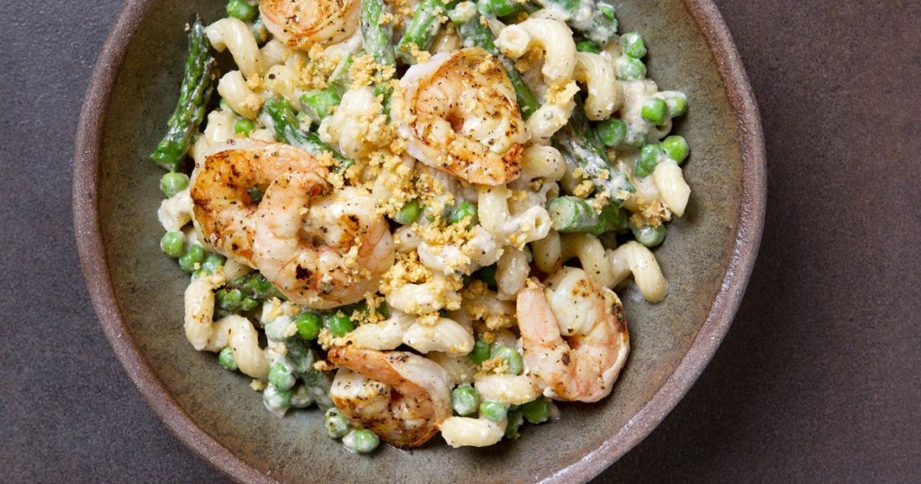 shrimp with noodles and peas in a bowl
