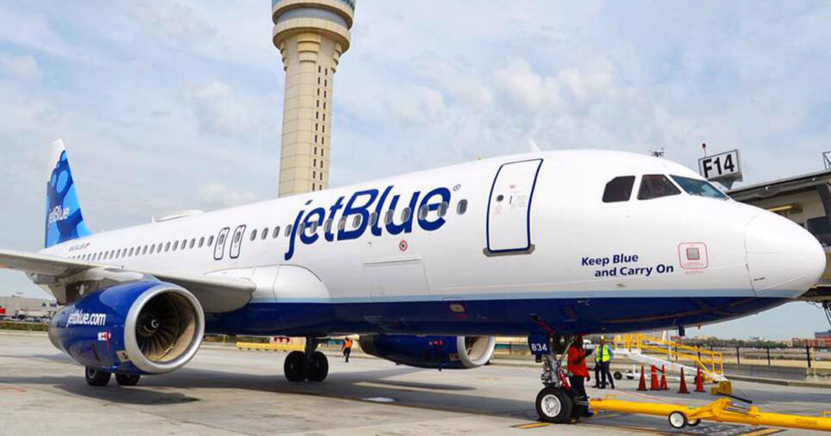 Money saving hacks and tips for booking airline flights – Jet Blue airplane on the tarmac
