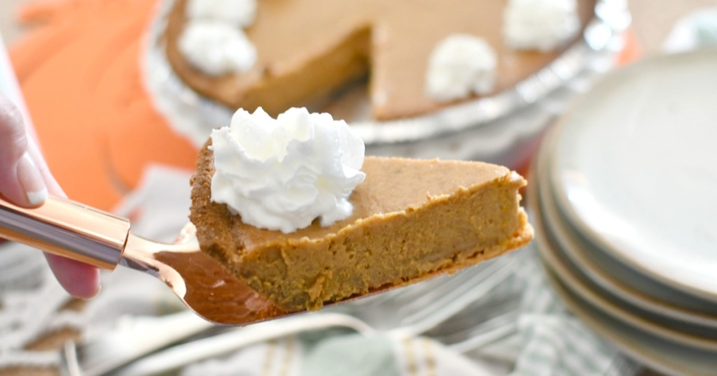 slice of pumpkin pie on a pie server