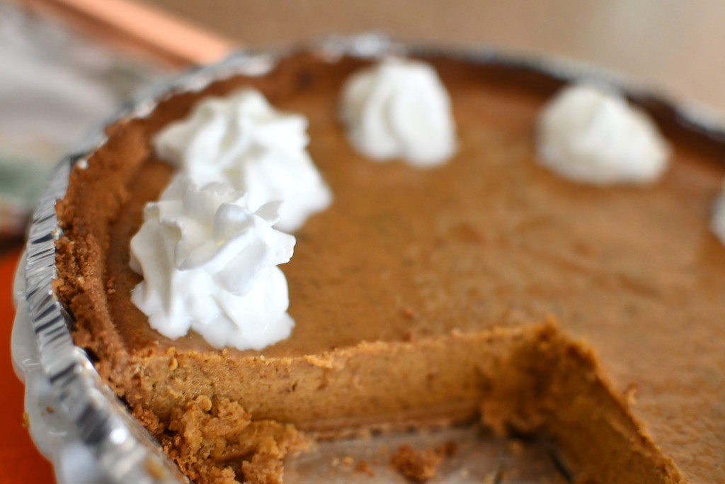 large slice out of pumpkin pie