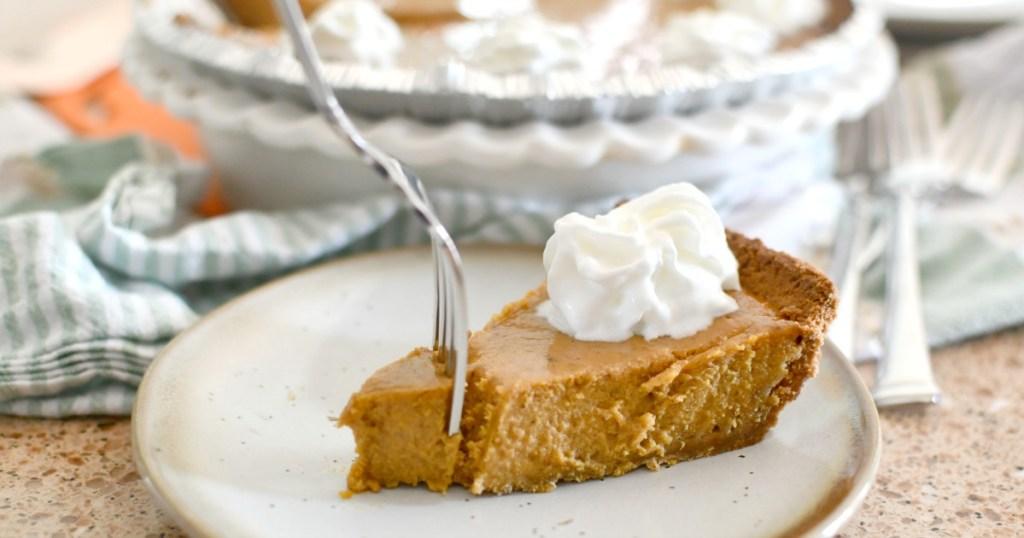 taking a bite of pumpkin pie