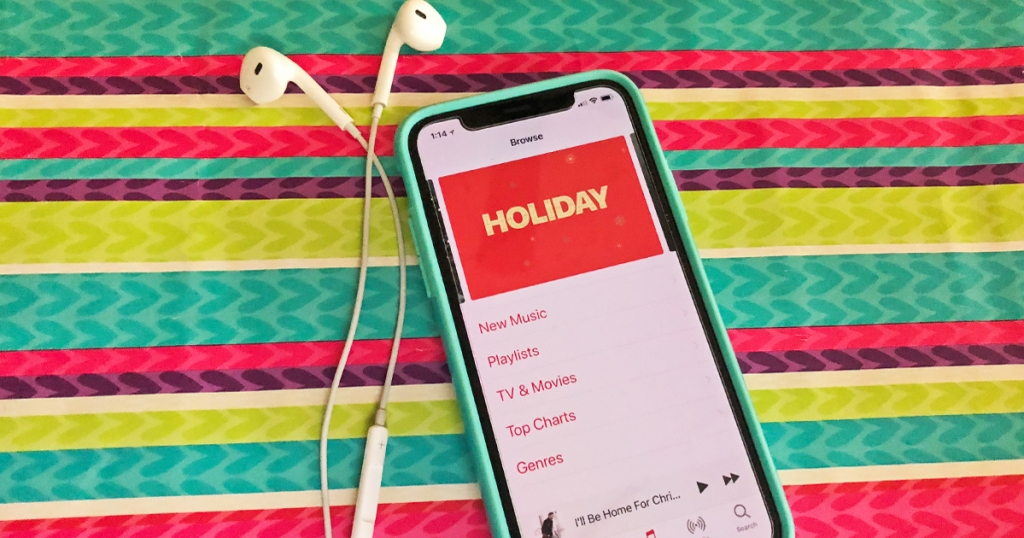 phone with holiday apple music and ear buds