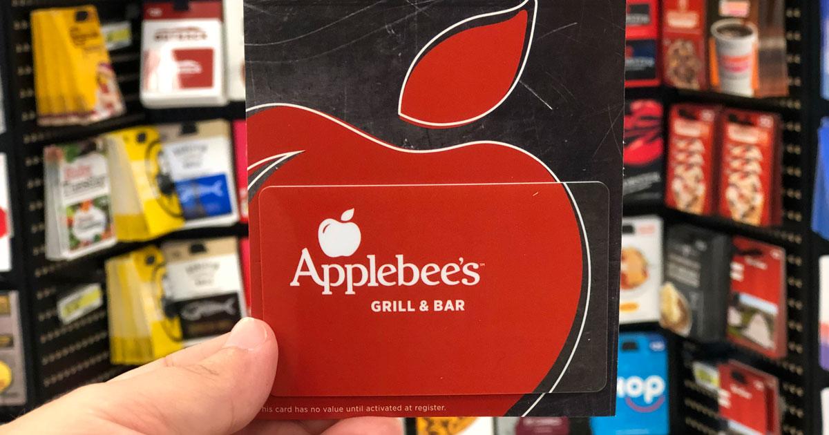 Hand holding Applebees gift card