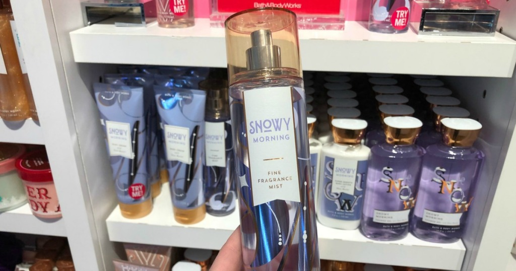 woman holding fragrance spray in-store