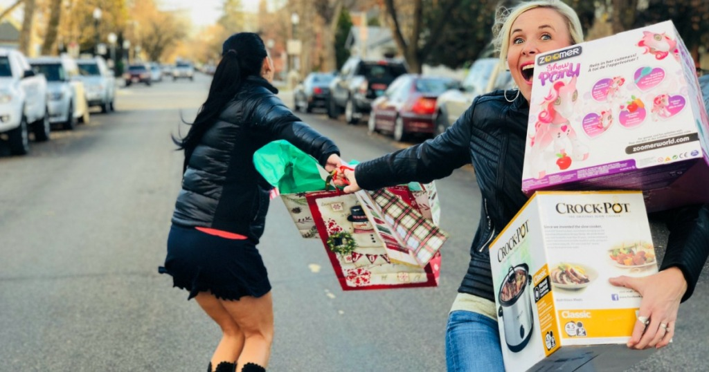 women with shopping bags and products