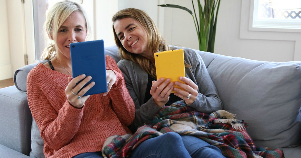 two women looking at their kindles
