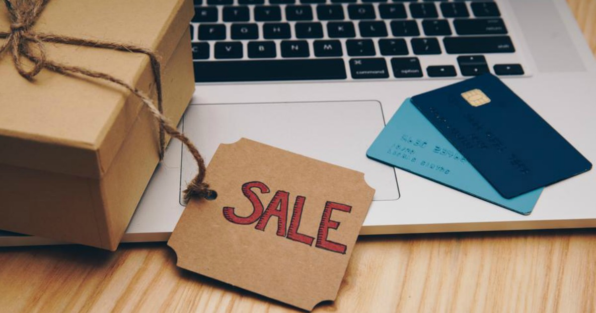 """a box with a tag that reads """"sale"""" on an open laptop"""