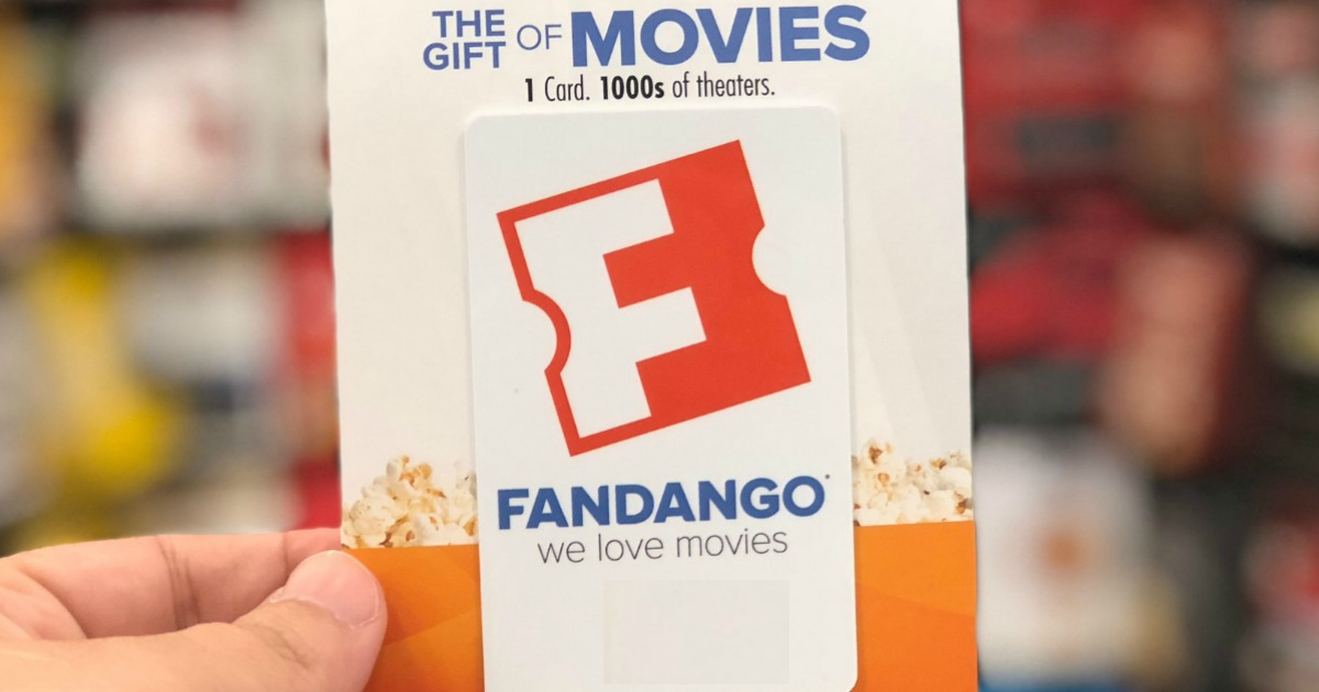 Fandango Gift Card held up in front of gift card display