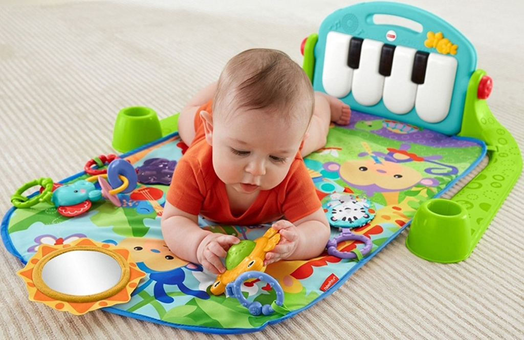 baby on piano learning pad