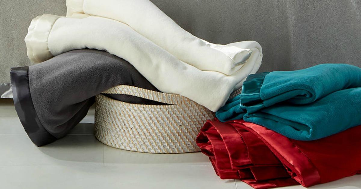 Marth Stewart Soft Fleece Blankets in white, black, green and red