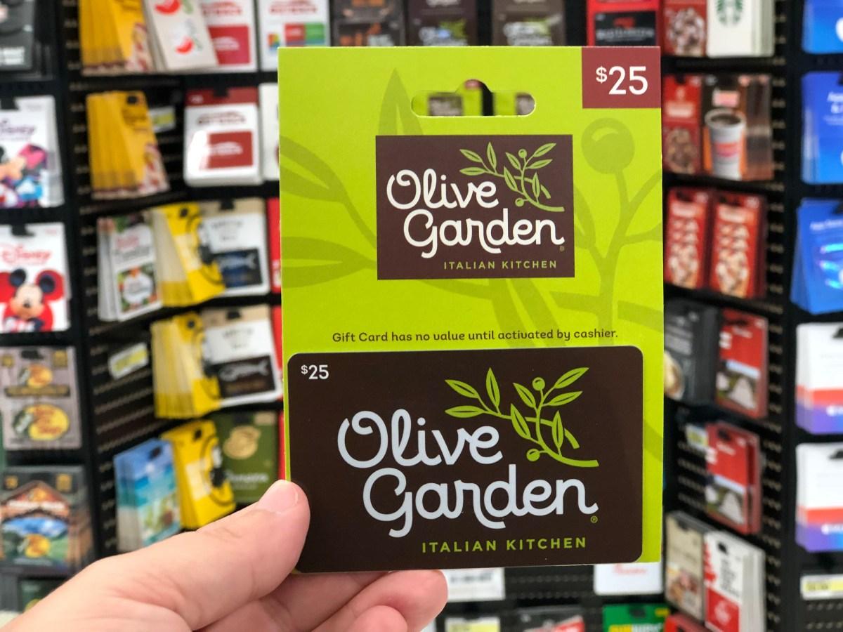 hand holding Olive Garden gift card