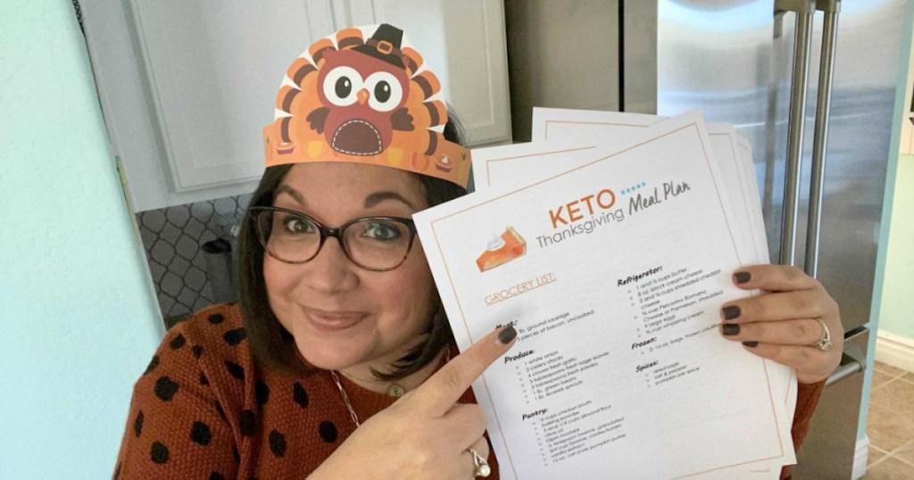 woman wearing thanksgiving hat pointing to keto meal plan