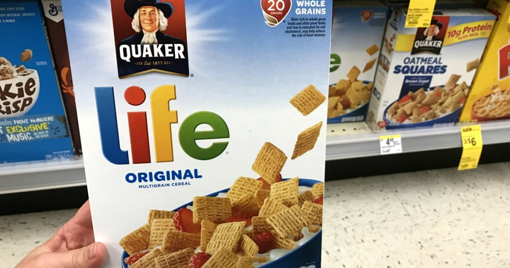 Hand holding Quaker Life Cereal