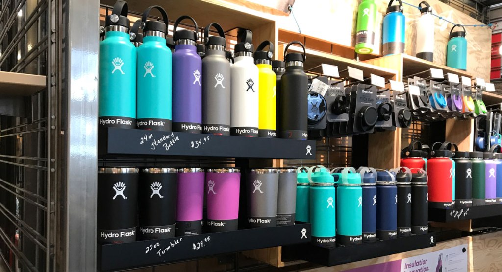 Hydroflask tumblers on a shelf in a store