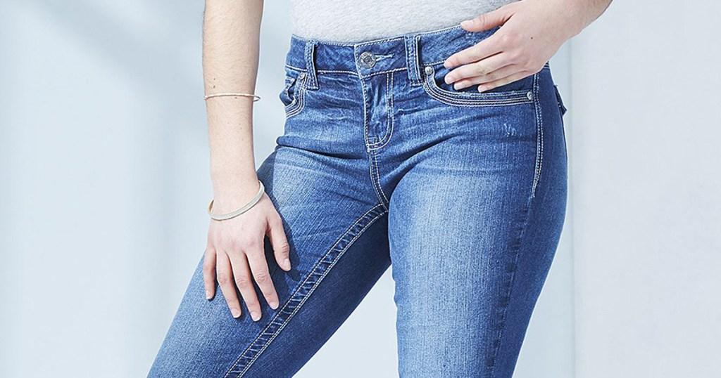 woman wearing seven7 jeans
