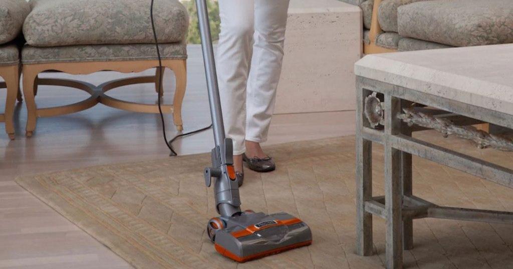 woman using Shark vacuum