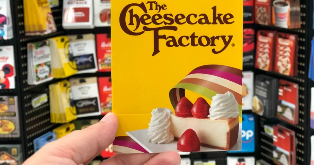 hand holding The Cheesecake Factory Gift Card