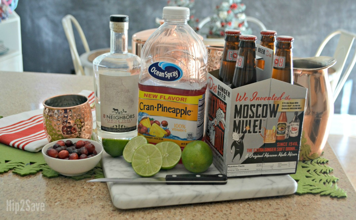make cranberry moscow mules for a crowd with this easy holiday punch recipe – ingredients on a counter