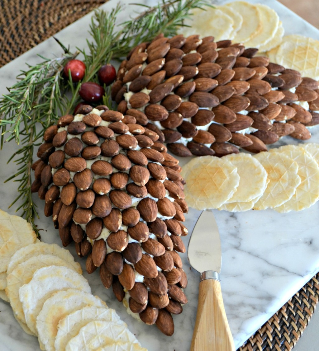 pinecone cheeseball on a cutting board