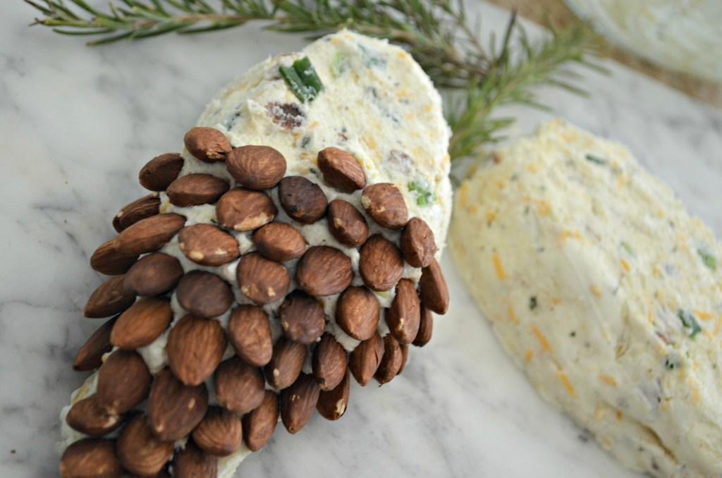adding almonds to a cheeseball